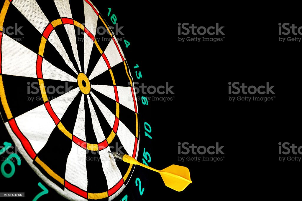 Dart missed the center of the target Darts stock photo
