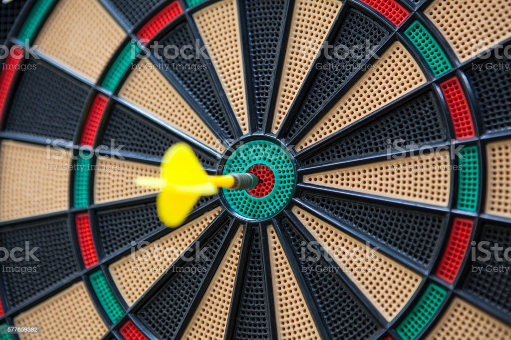 Dart on Dartboard Bullseye stock photo