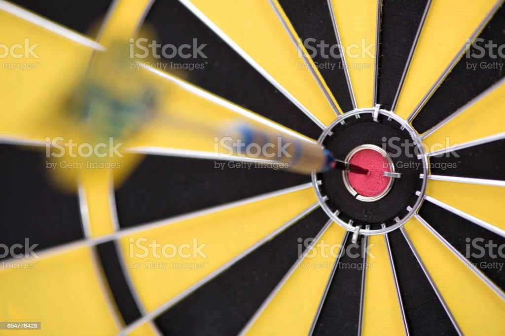 dart sport with arrow in target stock photo