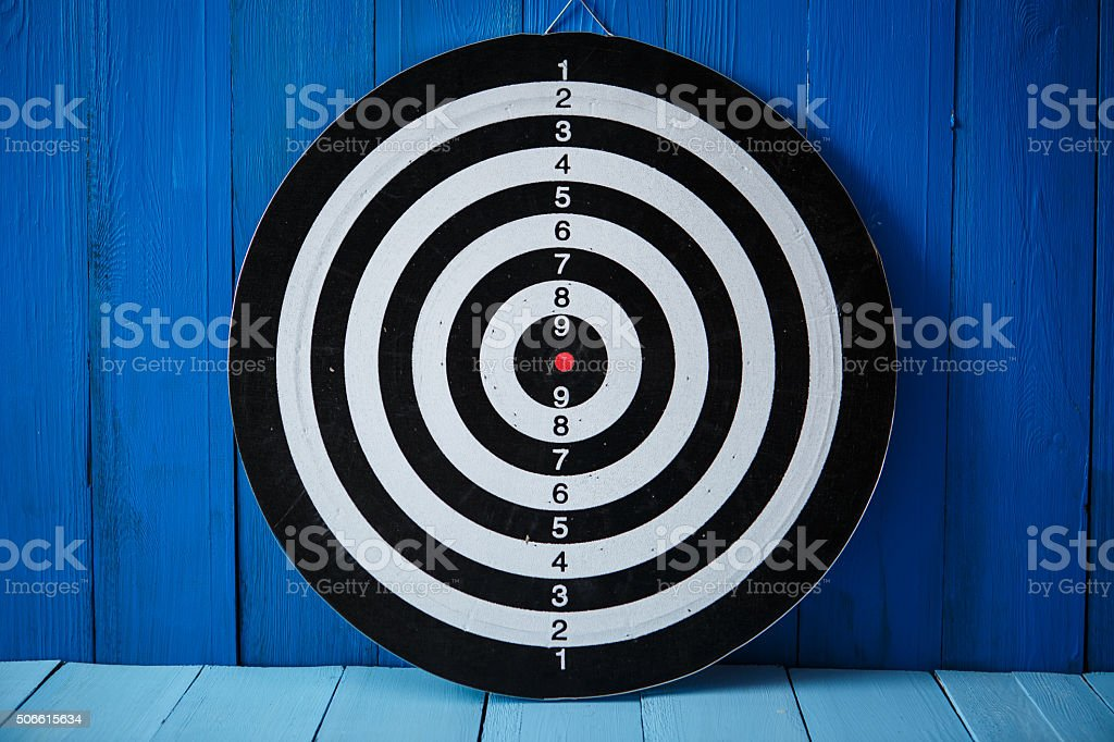 Dartboard on blue wood stock photo
