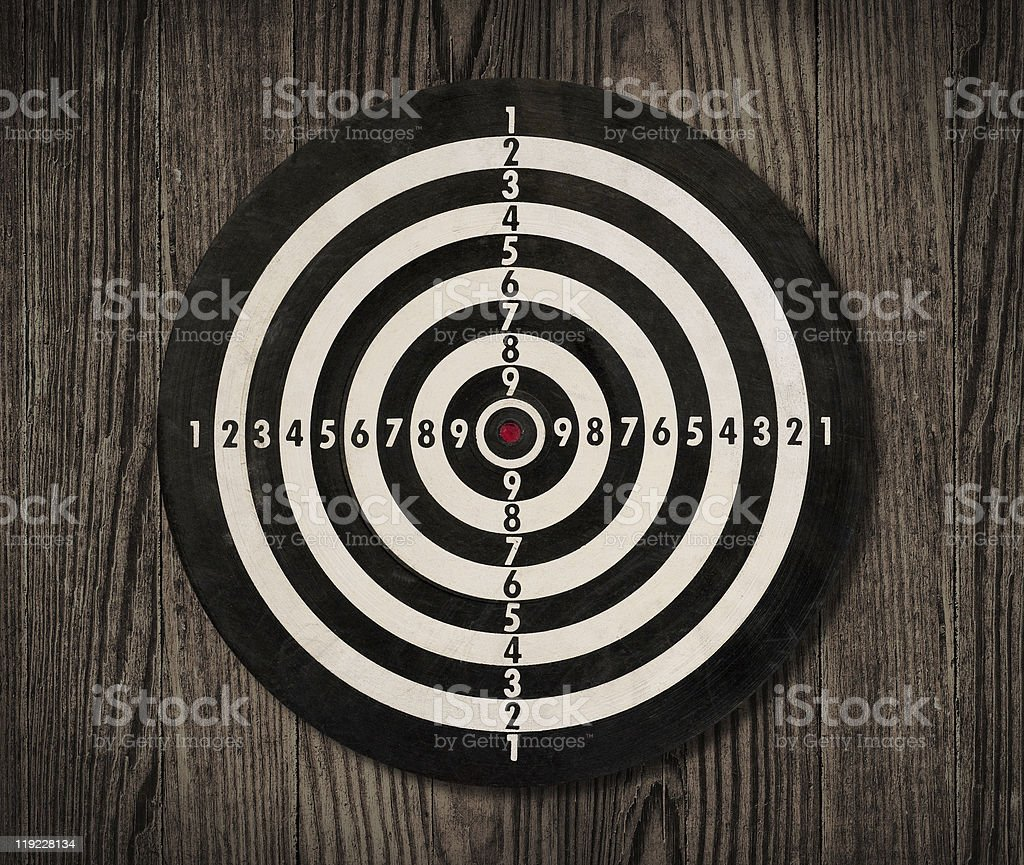 Dartboard on wooden wall, clipping path. royalty-free stock photo