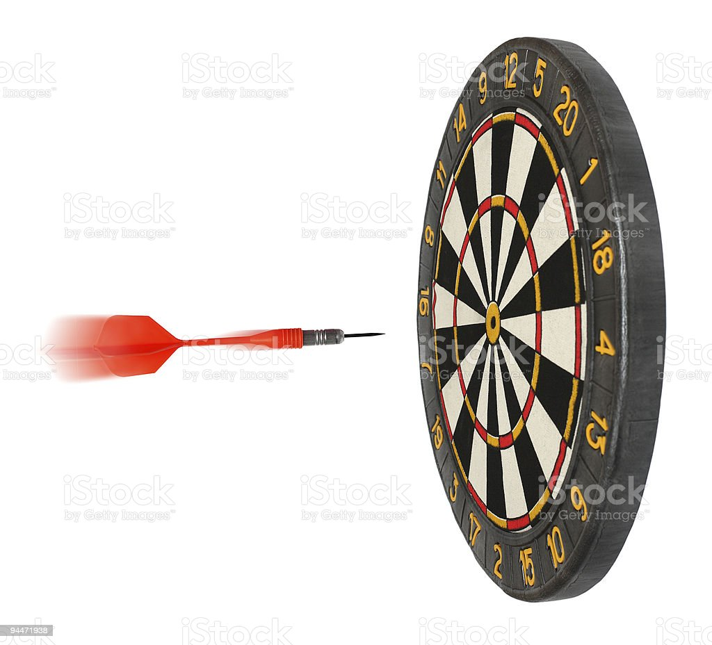 dartboard with dart flying in aim royalty-free stock photo