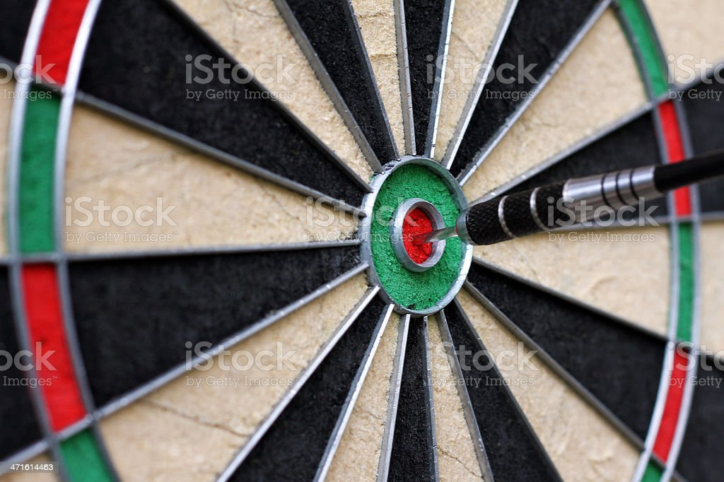 dartboard with dart in the center royalty-free stock photo