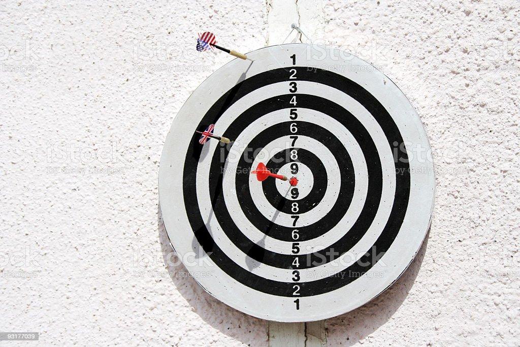 Dartboard with three arrows royalty-free stock photo