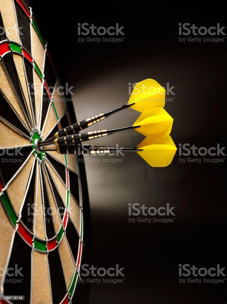 Dartboard with Three Darts stock photo