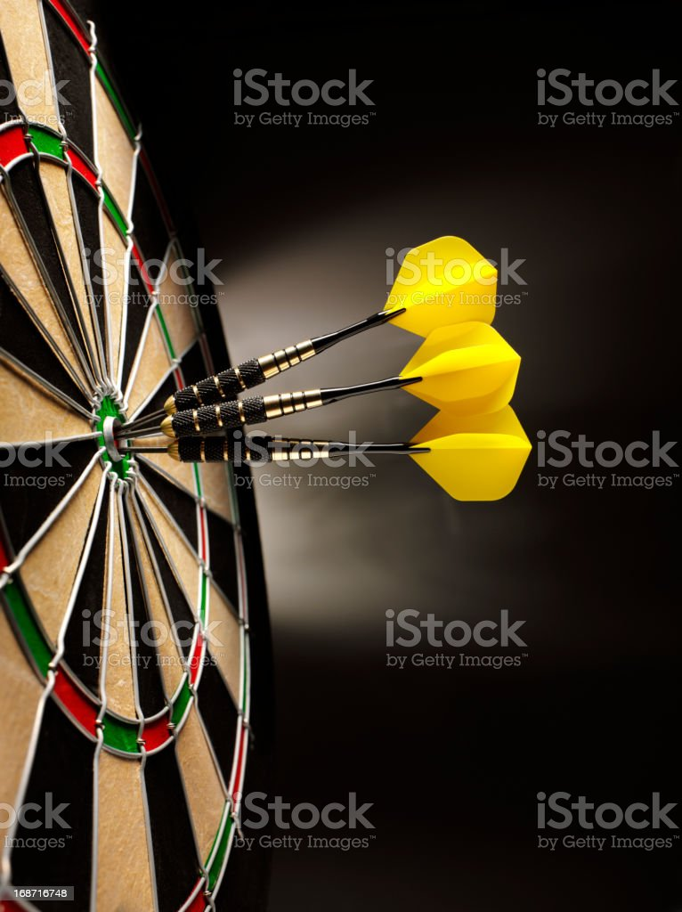 Dartboard with Three Darts stock photo