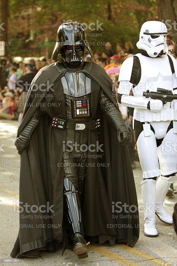 Darth Vader And Stormtrooper Walk In Halloween Parade royalty-free stock photo