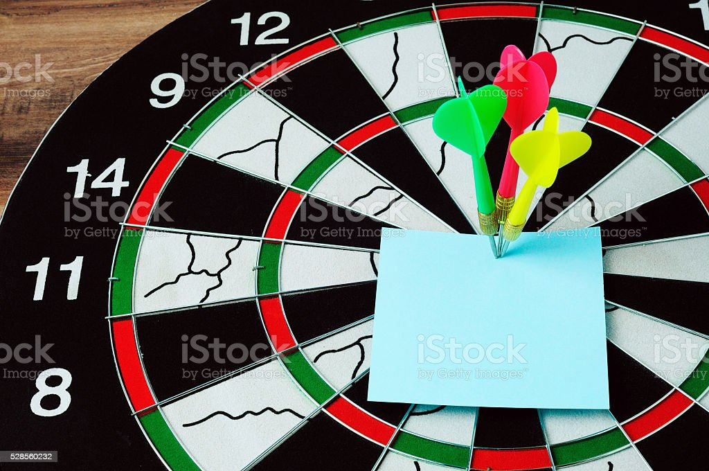 Darts and bull eyes with blank paper stock photo