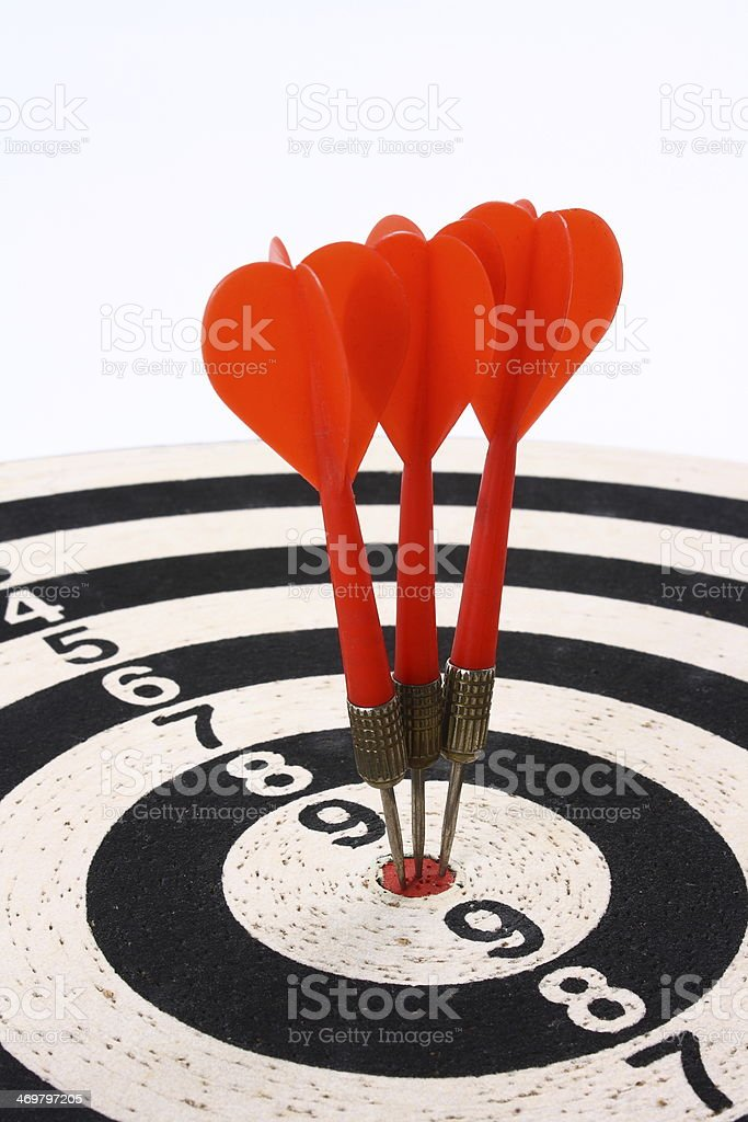 Darts and dartboard stock photo