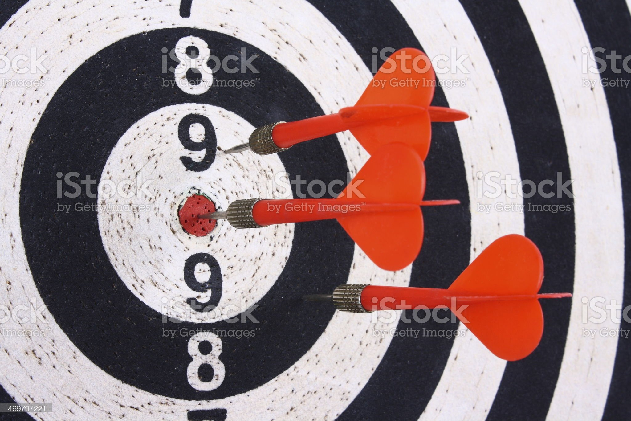 Darts and dartboard royalty-free stock photo