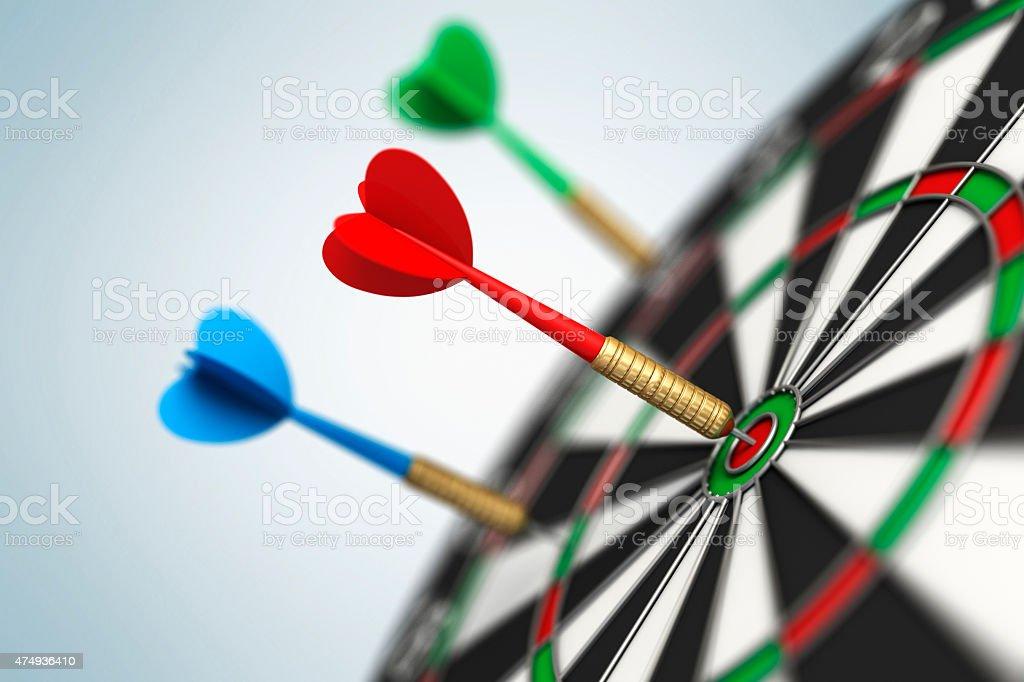 Darts arrow in bull's-eye stock photo