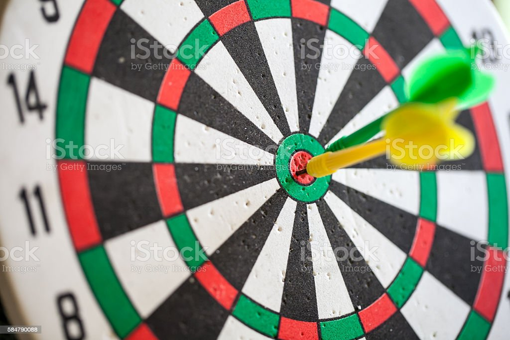 Darts arrows in the center of a target stock photo