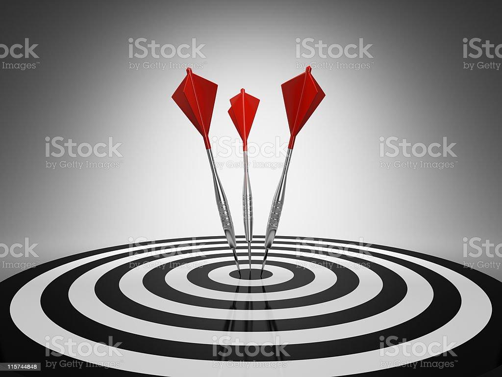 Darts hitting a target stock photo