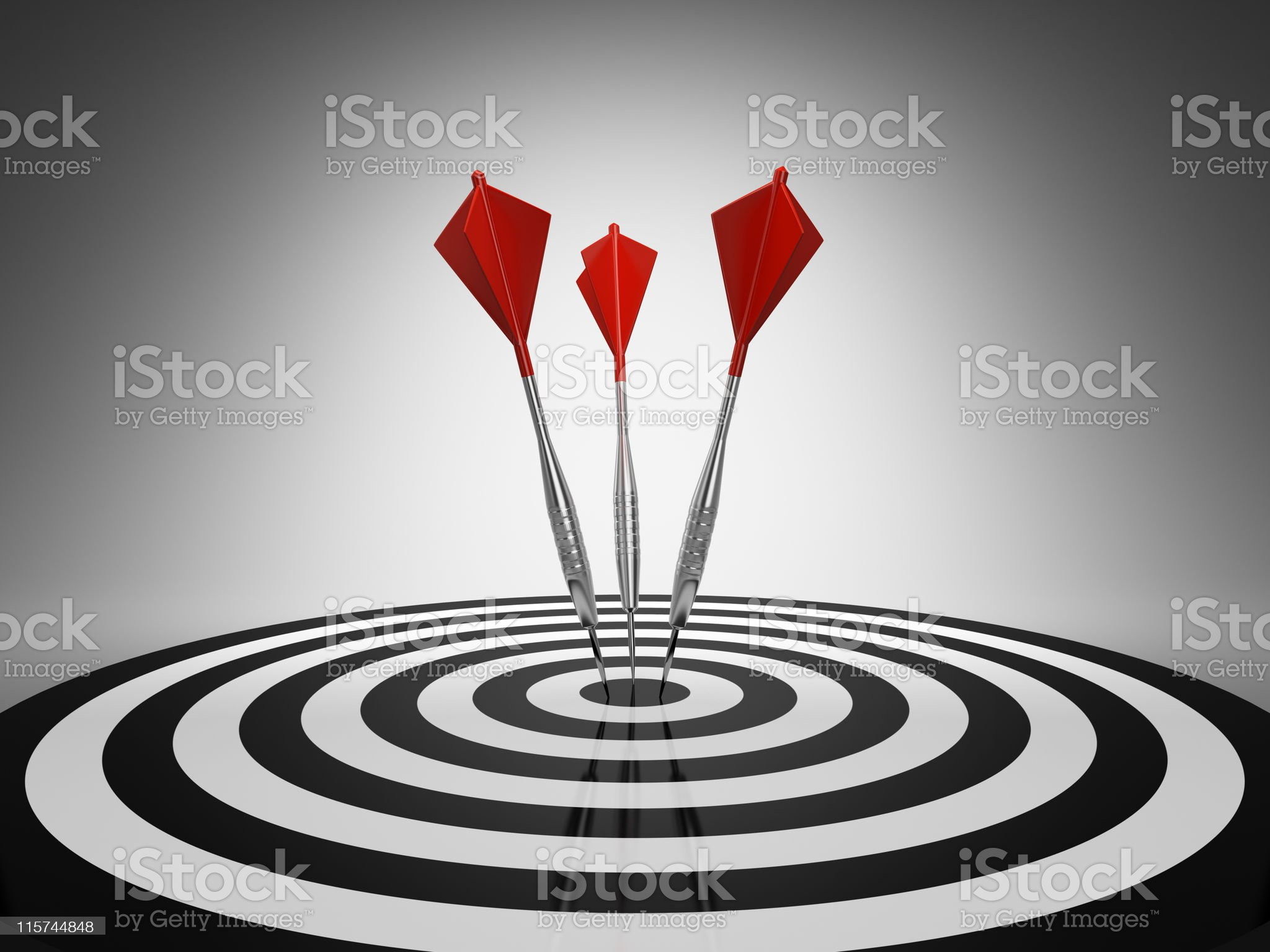 Darts hitting a target royalty-free stock photo