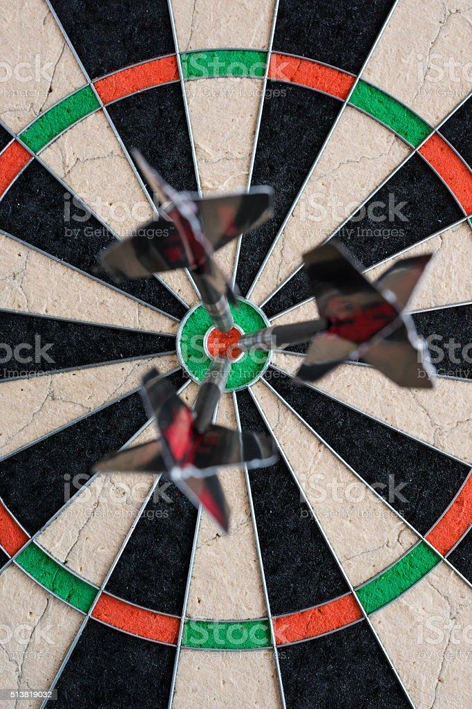 Topview of three darts sticking in a professional sisal dartboard....