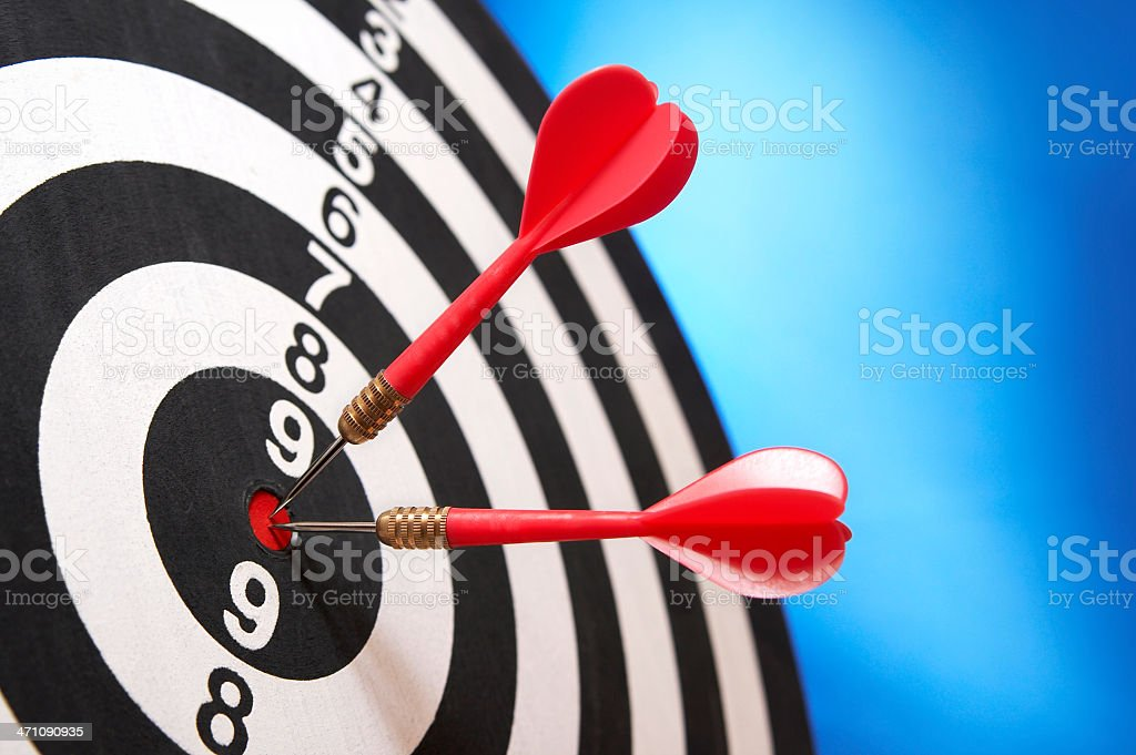 Darts hitting target royalty-free stock photo