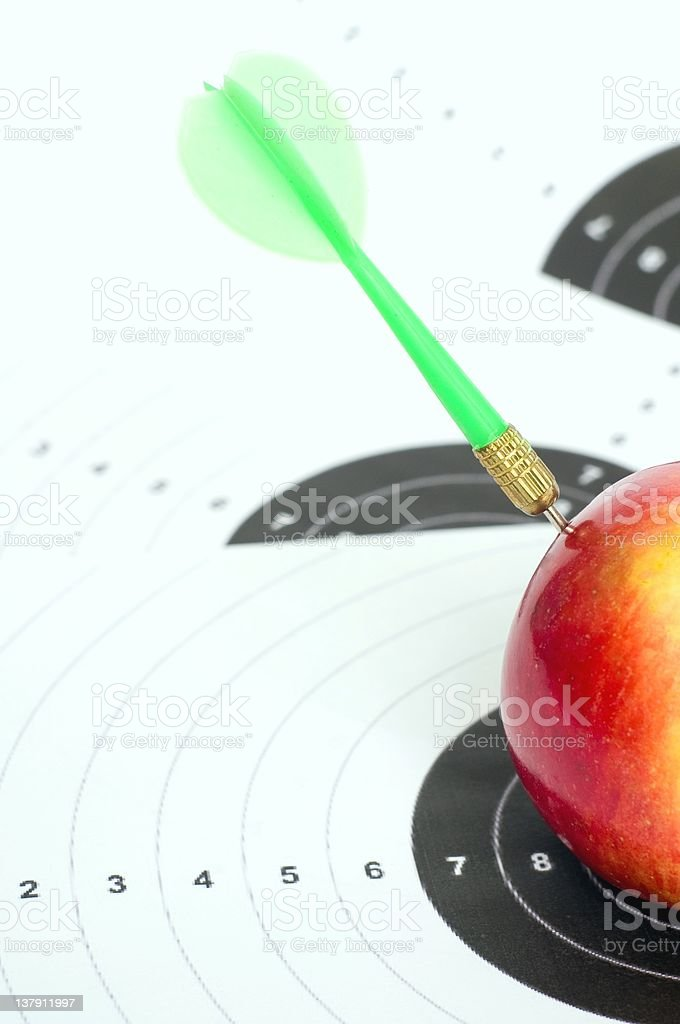 Darts in apple. royalty-free stock photo