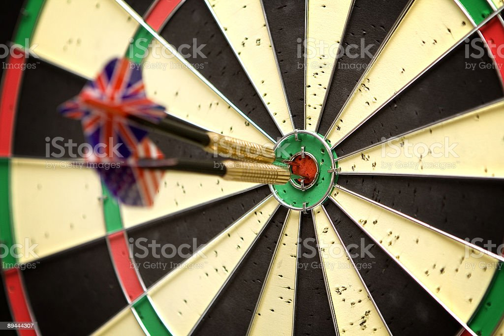 Darts in bull's eye royalty-free stock photo