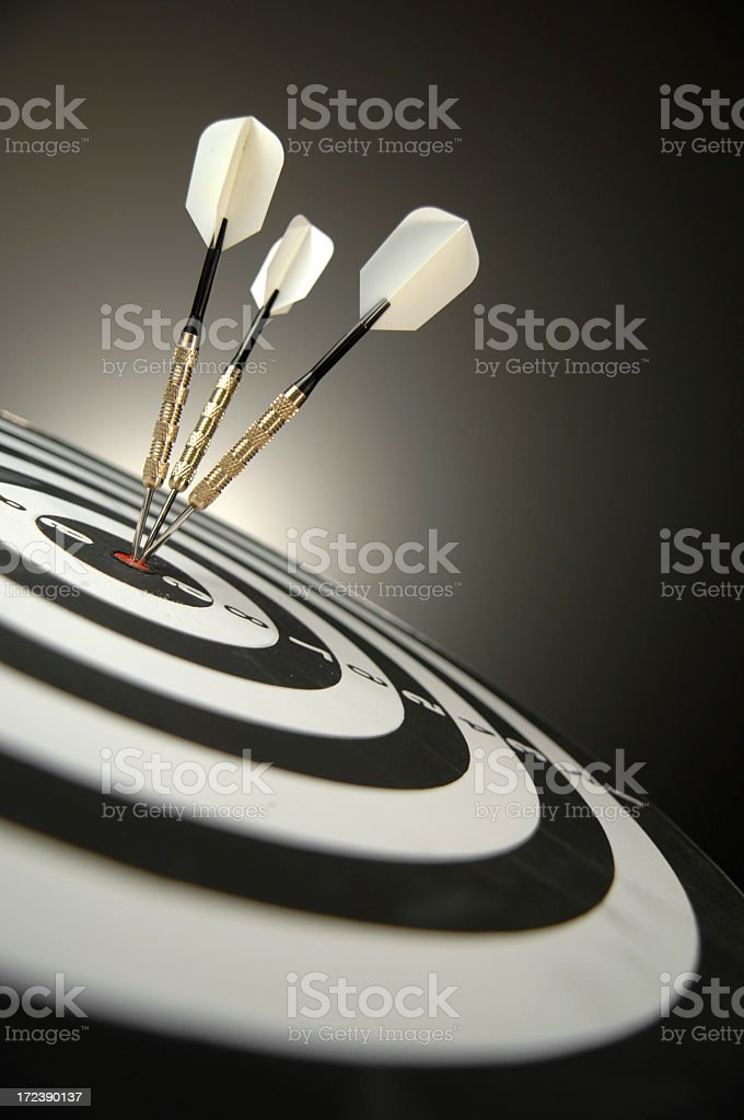 Darts in Bullseye on Dartboard stock photo