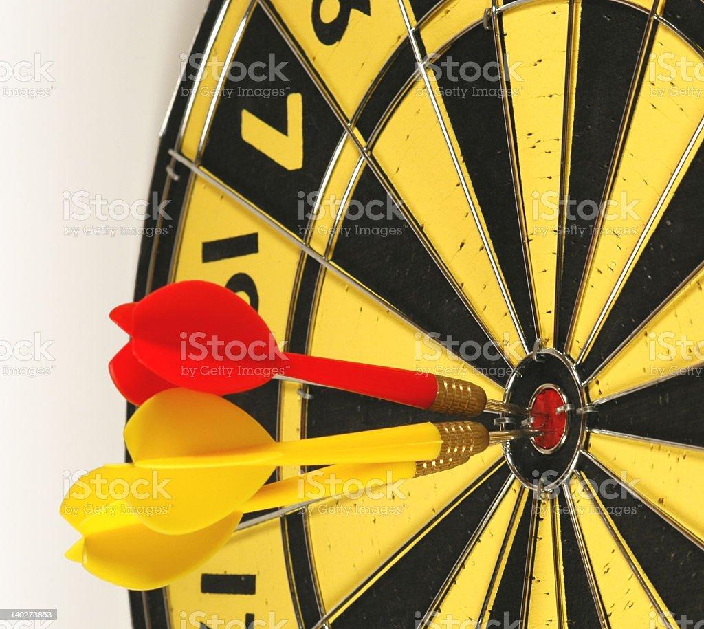 Darts in bullseye royalty-free stock photo