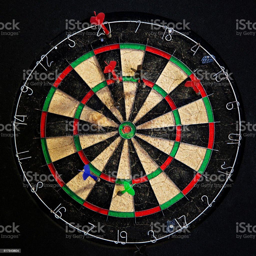 Darts on a Board stock photo