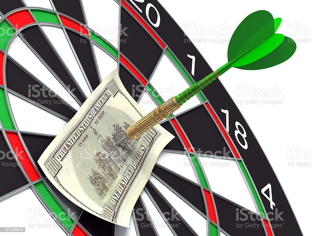 Darts target and 100 dollars in bull's-eye royalty-free stock photo