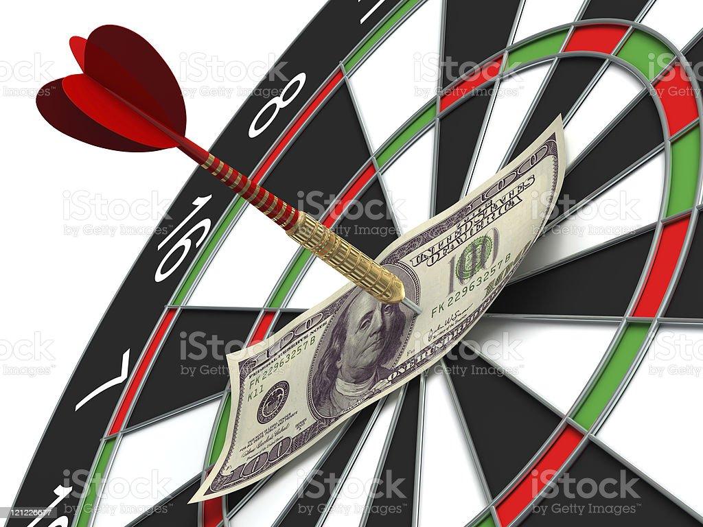 Darts target and 100 dollars in bull's-eye stock photo