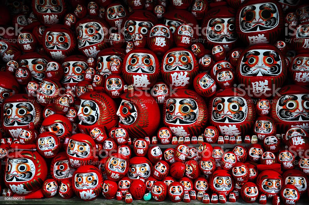 Daruma or red-painted good-luck doll in Japan stock photo