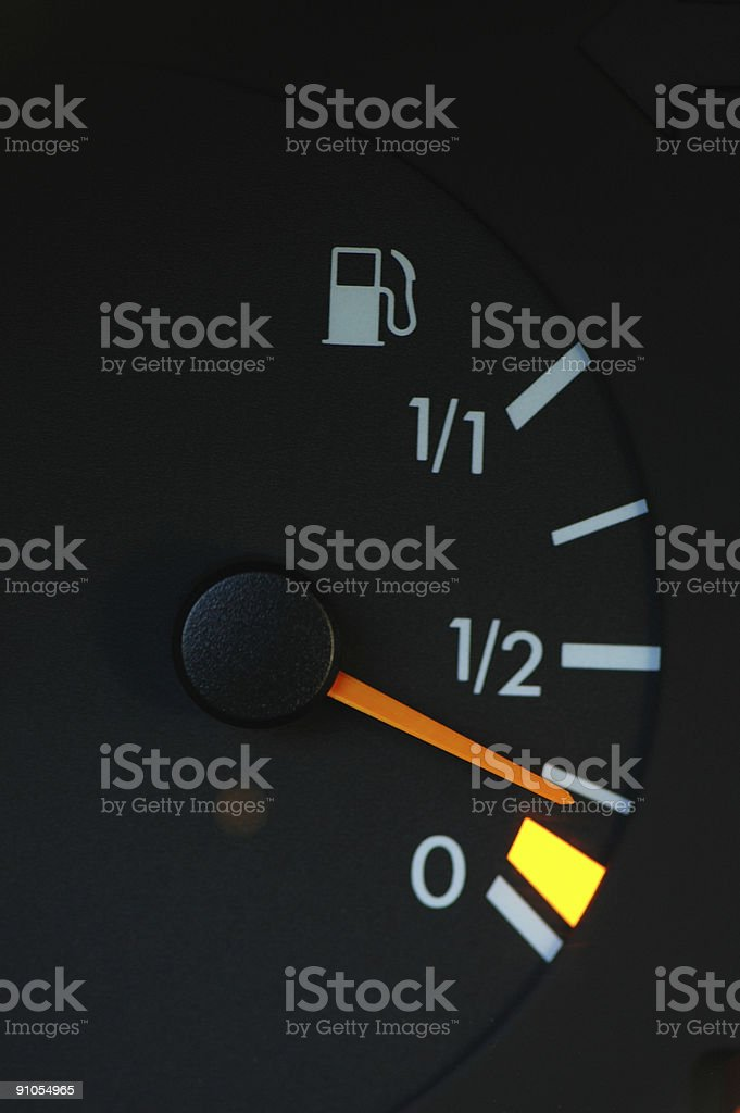 Dashboard meter showing low petrol level royalty-free stock photo