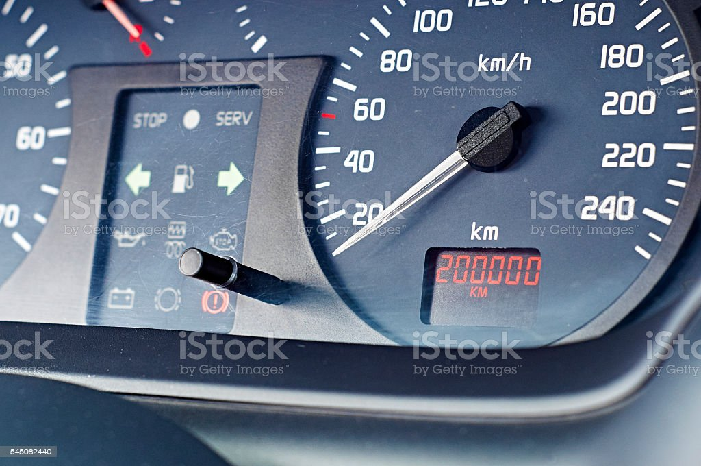 Dashboard of a car with big mileage stock photo