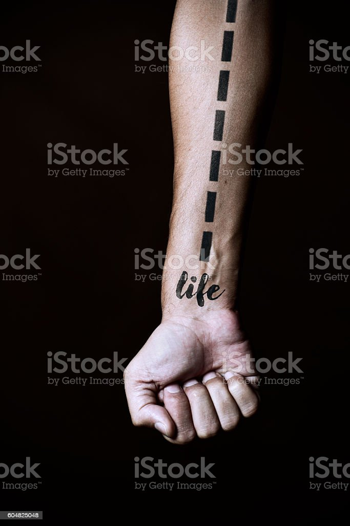 dashed line and word life in a forearm stock photo