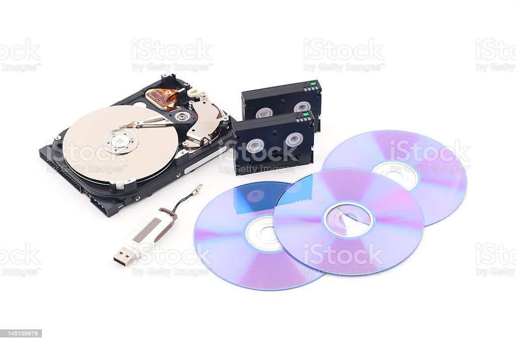 Data backup - hdd, cassette, flash memory drive and cd royalty-free stock photo