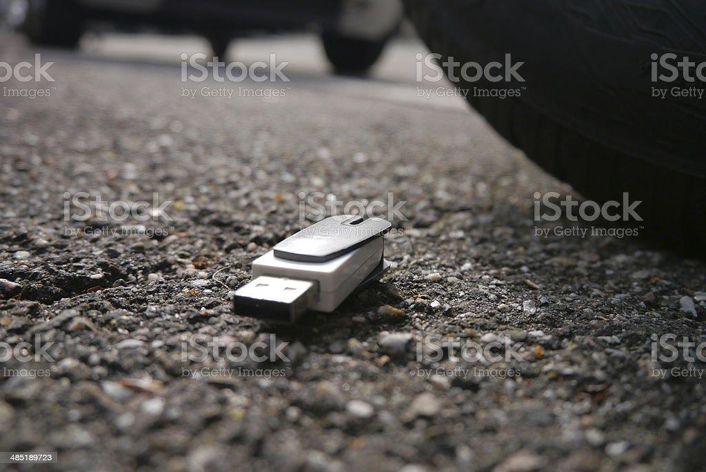 data loss, data breach. usb dropped on street stock photo