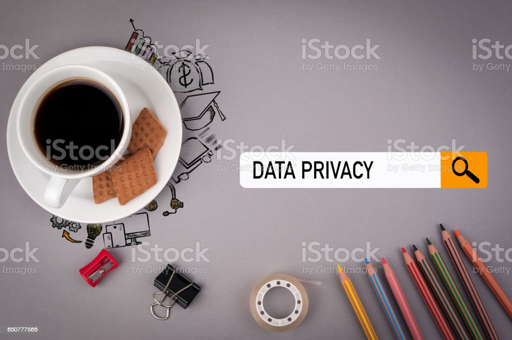 data privacy concept. Gray office desk with the inscription stock photo