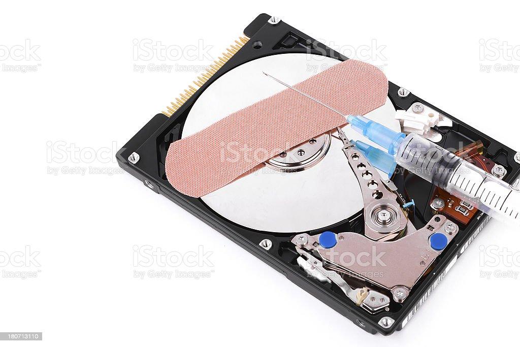 Data Rescue:hard disk and syringe royalty-free stock photo