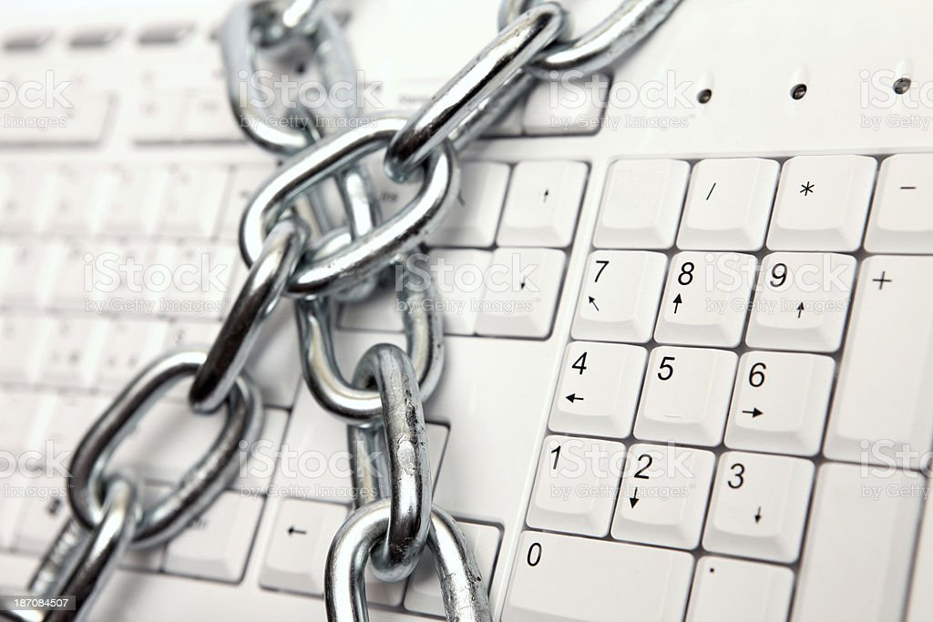 Data security: chain locking and protecting computer keyboard royalty-free stock photo
