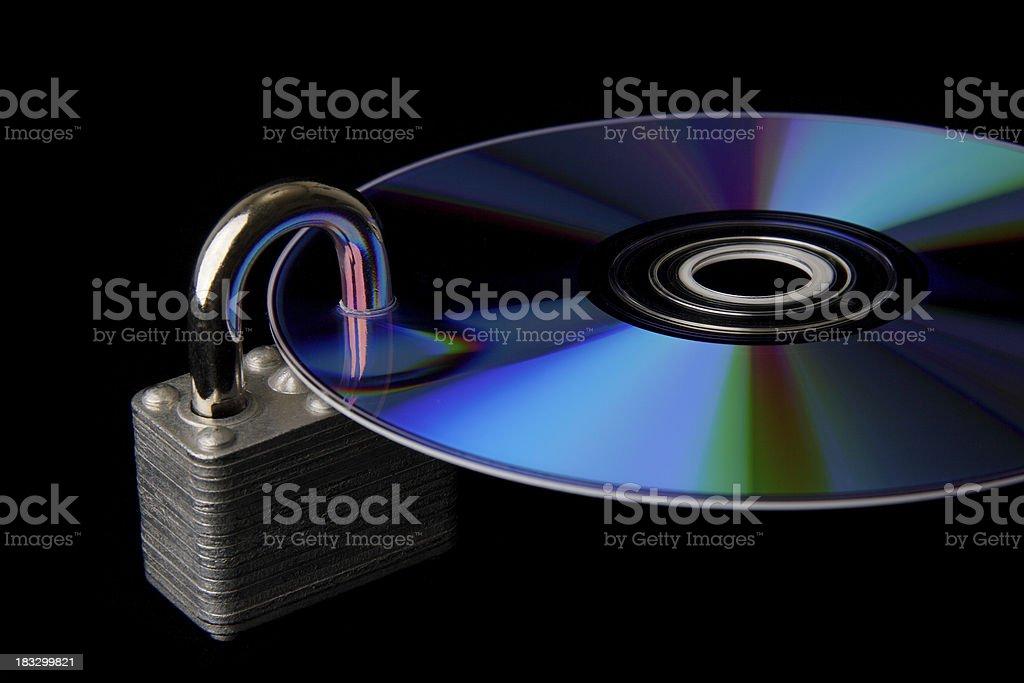 Data Security: Lock Through Disc royalty-free stock photo