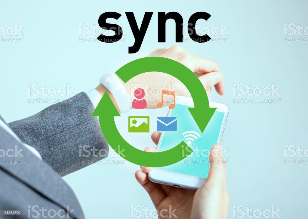 data sync between smart phone and smart watch stock photo