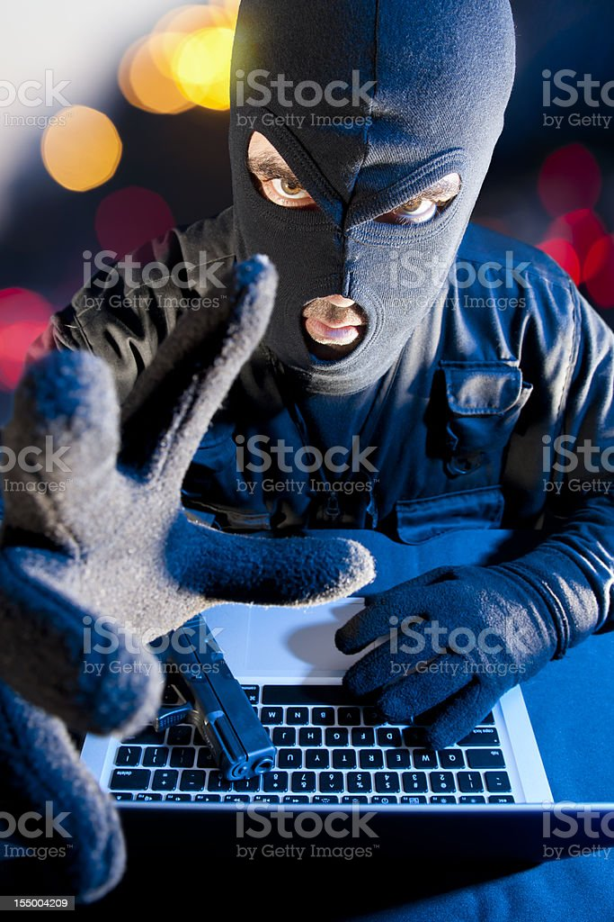 Data thief stealing information from laptop royalty-free stock photo
