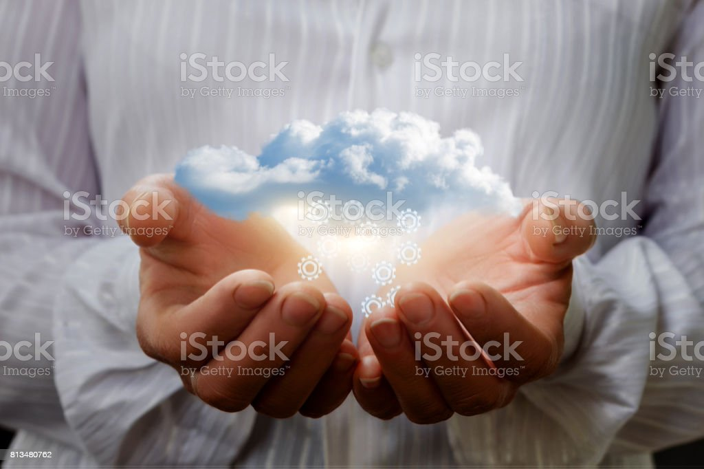 Data transfer from the cloud in the hands. stock photo