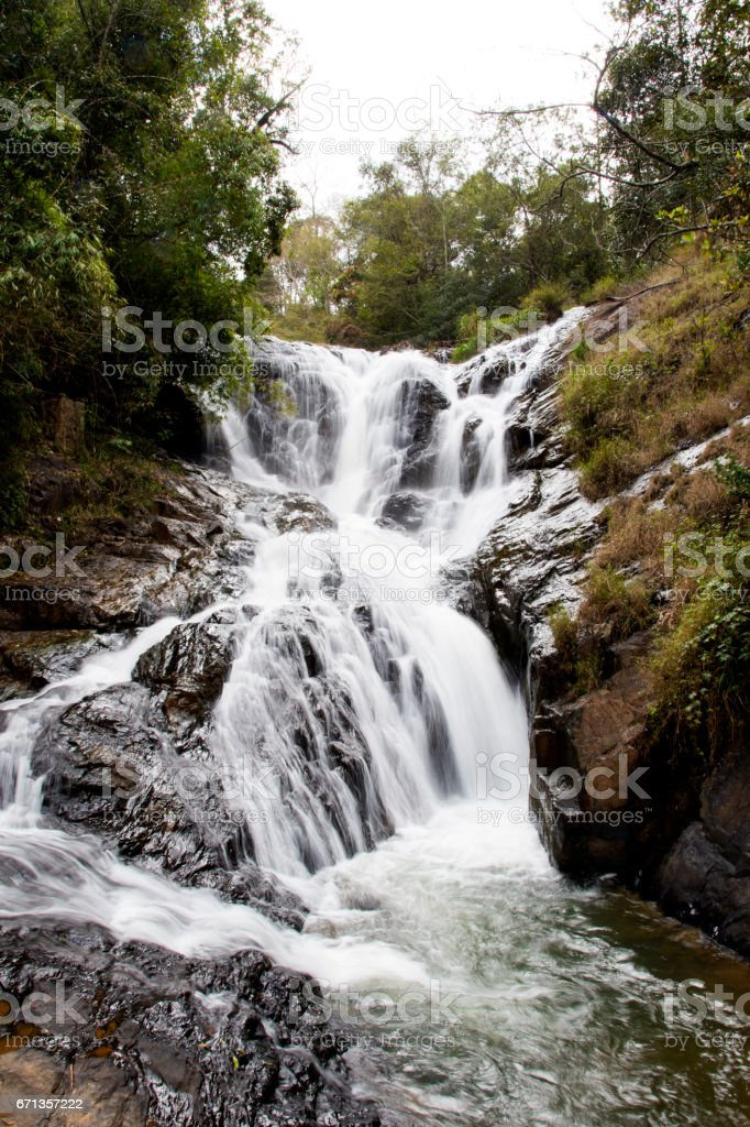 Datanla waterfall, vertical, in Dalat city, Vietnam. stock photo