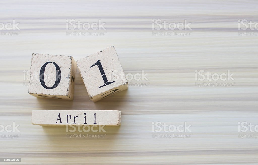 Date April 1 on wooden calendar on wooden background stock photo