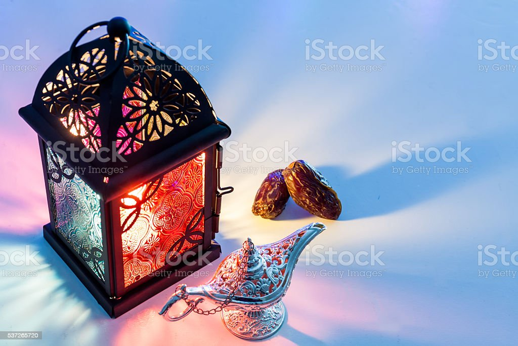 Date fruits Aladdin's lamp and arabic lantern. stock photo