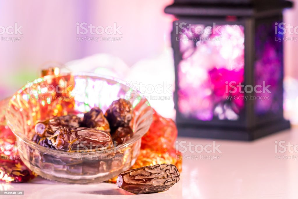 Date fruits in illuminated out of focus background stock photo