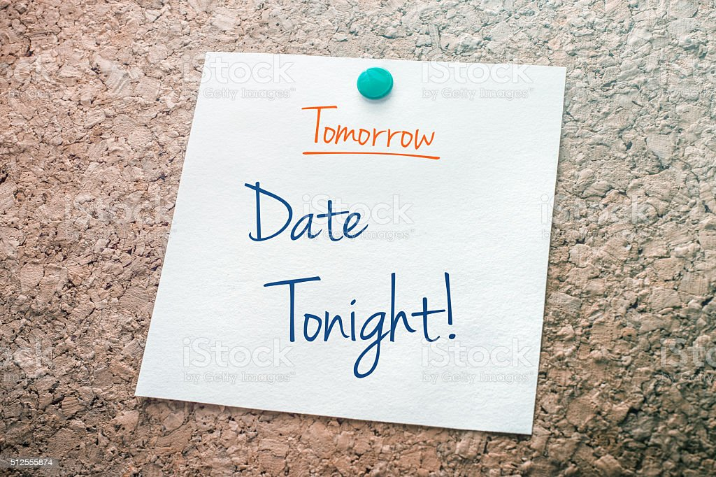 Date Tonight Reminder For Tomorrow Pinned On Cork Board stock photo