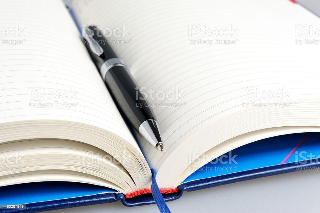 Datebook with black pen close up stock photo