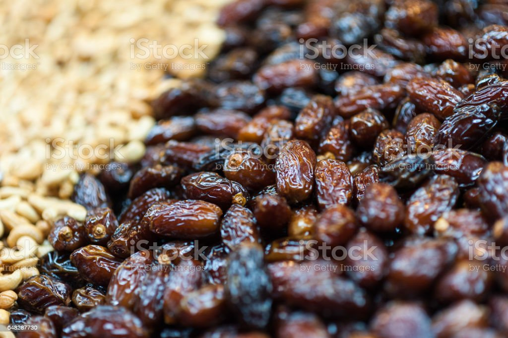 Dates and nuts for sale on display on a counter stock photo