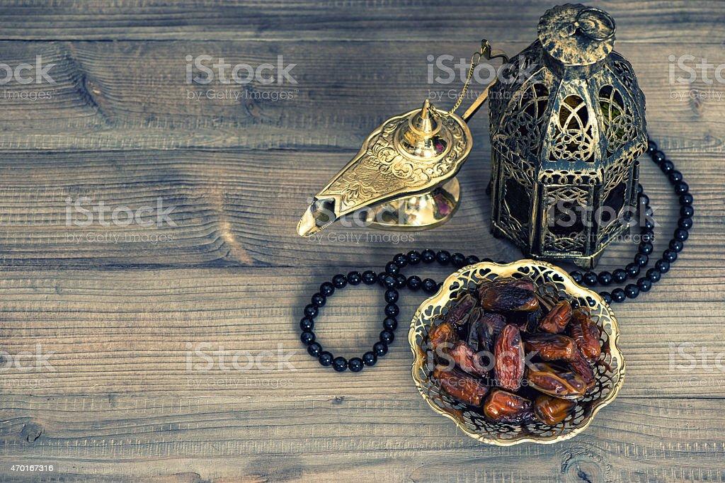 Dates, arabian lantern and rosary. Islamic holidays concept stock photo
