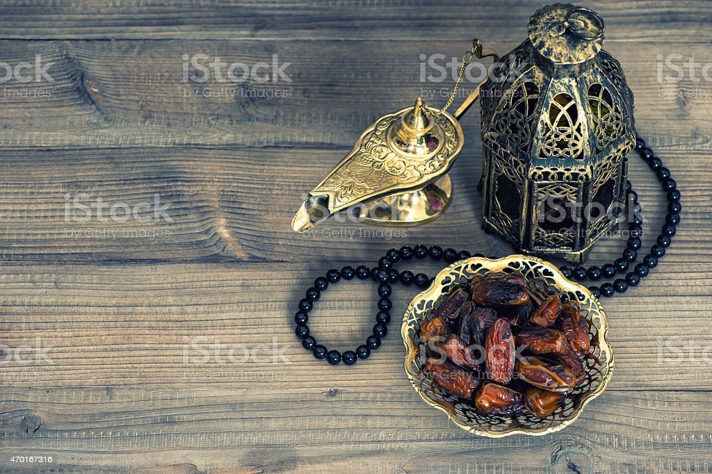 Dates, arabian lantern and rosary. Islamic holidays concept stock photo