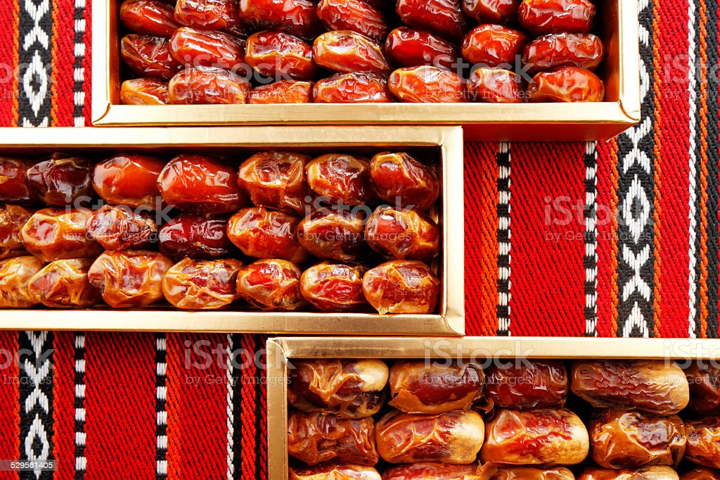 Dates arranged on Arabian woven fabric stock photo